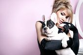 picture of pug  - Elegant beautiful blonde woman posing witg pug dog over pink background - JPG