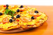 picture of hot fresh pizza  - hot fresh pizza with olives closeup on wooden background - JPG
