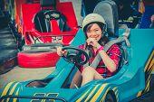 image of karts  - Cute Thai girl is driving Go - JPG