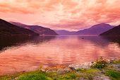 image of fjord  - Sunset in fjord Hardanger Norway  - JPG