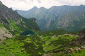 image of emerald  - Picturesque view stretches over emerald pond and mountain ridge in Tatras Slovakia - JPG