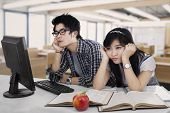 pic of boring  - Portrait of two asian students bored in the class room - JPG