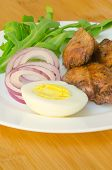 pic of liver fry  - Roasted chicken liver with vegetable on wooden background - JPG