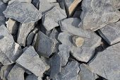 stock photo of shale  - background with a lot of grey shale stones lying on the ground - JPG
