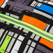 picture of zipper  - Close up zipper on a colorful background - JPG