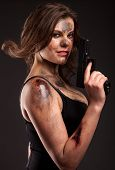 image of gunshot  - Sexy woman with gun - JPG