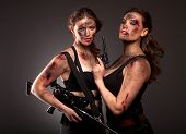 foto of girls guns  - Group of sexy woman like riot woman. Girls with weapon, gun, rifle and knife. With blood on face.