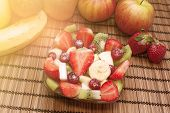 picture of fruit bowl  - Diet healthy fruit salad in glass bowl healthy breakfast weight loss concept warm filter applied - JPG