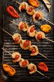 stock photo of grill  - Grilled Parmesan crust shrimp with chery tomatoes on the grill with grilled mini bell peppers - JPG