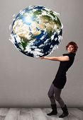foto of cartographer  - Pretty young girl holding 3d planet earth - JPG
