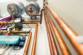 stock photo of boiler  - copper pipes engineering in boiler - JPG