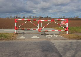 picture of safety barrier  - Bicycle Safety Barrier at Bike Lane in Red and White Stripes  - JPG