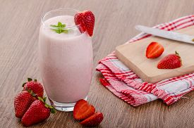 picture of fruit shake  - Strawberry smoothie nice and clean fresh fruits leaf of mint - JPG