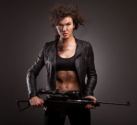 stock photo of sniper  - Sexy military woman posing with sniper gun - JPG