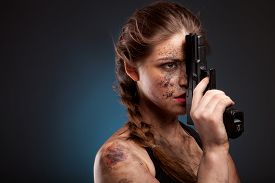 picture of girls guns  - Sexy girl in a black dress holding a gun - JPG
