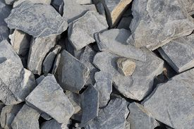pic of shale  - background with a lot of grey shale stones lying on the ground - JPG