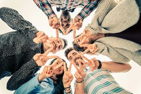 foto of star shape  - Multiracial group of people in circle making a star shape with hands gesture  - JPG