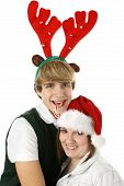 stock photo of christmas hat  - adorable teen couple in christmas hats - JPG