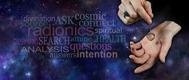 foto of pendulum  - Female hand holding a clear quartz crystal dowsing pendulum over hand on a wide deep blue outer space background with relevant word cloud on left side - JPG