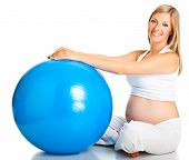 stock photo of pregnant woman  - Pregnant woman exercising with gymnastic ball isolated on white background - JPG