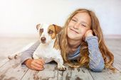 Happy child with dog. Portrait girl with pet poster