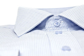 foto of nic  - picture of a nicly folded men shirt with focus on the collars - JPG
