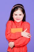 Such An Interesting Book. Cute Little Girl Holding Fiction Book. Adorable School Child With Activity poster