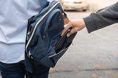 Thief Stealing The Wallet Or Mobile Phone From Behind Young Caucasian Woman Bag On Street, Thief, Cr poster