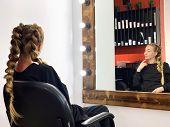Hairdresser Braiding Womans Hair In Hairdressing Salon poster