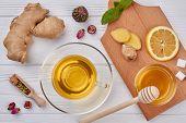 Flat Lay Honey, Lemon, Ginger Tea. Cup Of Ginger Tea With Lemon, Honey, Ginger Root And Mint Leaves  poster