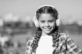 Liking What You Do Is Happiness. Happy Child Wear Headphones. Happy Small Girl. Small Girl Listen To poster