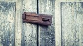 Vintage Rustic Stain Old Lock Equipment On Painted Wooden Door. Old Lock On The Door, Lock On The Do poster