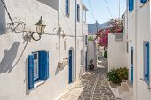 View of a typical narrow street in old town of Naoussa, Paros island, Cyclades, Greece poster