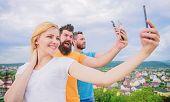 Todays Selfie. Pretty Woman And Men Holding Smartphones In Hands. People Enjoy Selfie Shooting On Na poster