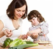 pic of mother child  - mother and daughter cooking salad at the kitchen - JPG