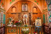picture of guadalupe  - Guadalupe Shrine Mission Basilica San Juan Capistrano Church California. Mexican peasant Juan Diego Statue with Guadalupe on his tunic.