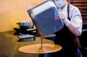 Cook Woman Is Mixing Chocolate Cream With Professional Spatula In The Chocolate Shop. Elted Dark Cho poster
