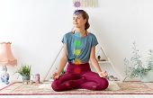 mindfulness, spirituality and healthy lifestyle concept - woman meditating in lotus pose at yoga stu poster