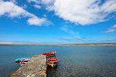 image of pontoon boat  - three fisherman boats docked in pontoon in lake - JPG