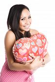 stock photo of heart shape  - A beautiful asian woman hugging a heart - JPG