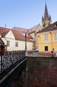 stock photo of foreshortening  - Foreshortening view of the bridge of lies and the cathedral of Sibiu in Romania - JPG