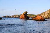 stock photo of safe haven  - On the west of the mainland of the shetland islands just below the famous St Ninians isle is this wonderful little bay - JPG