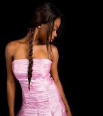 stock photo of female model  - A beautiful young African American lady is looking on her side - JPG