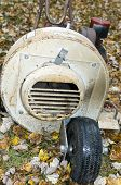 stock photo of leaf-blower  - old rusty leaf blower for lawn maintenance in the autumn - JPG