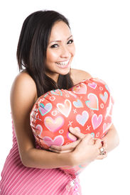 picture of heart shape  - A beautiful asian woman hugging a heart - JPG