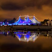 "picture of galway  - ""Big Top"" circus style blue tent and row of lights on the bank of Corrib river in Galway Ireland - JPG"