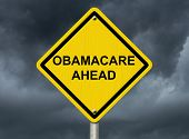 stock photo of mandate  - An warning sign against a stormy sky with words Obamacare Ahead Warning about Obamacare - JPG