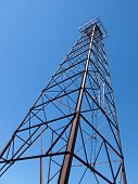 stock photo of derrick  - This 90 foot oil derrick typical of the numerous drilling rigs used in southwestern Michigan during the late 1930s now stands near the Depot Museum in the village of Bloomingdale Michigan - JPG