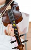 stock photo of wench  - Prodigy playing the violin in the school of music - JPG