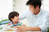 foto of homework  - Father Helping Son With Homework - JPG